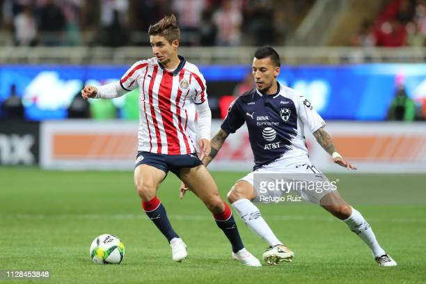 Isaac Brizuela of Chivas fights for the ball with Leonel Vangioni of Monterrey during the 9th round match between Chivas and Monterrey as part of the...
