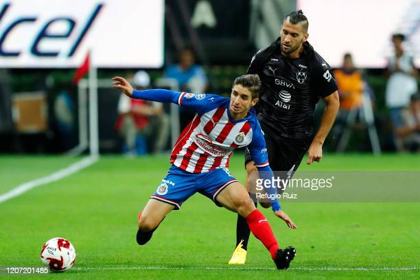 Isaac Brizuela of Chivas fights for the ball with Nicolas Sanchez of Monterrey during the 10th round match between Chivas v Monterrey as part of the...