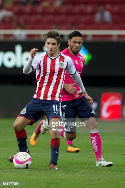 Isaac Brizuela of Chivas fights for the ball with Rodrigo Millar of Morelia during the 13th round match between Chivas and Morelia as part of the...