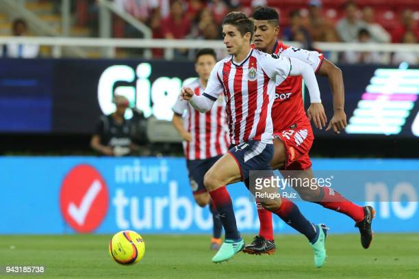 Isaac Brizuela of Chivas fights for the ball with Wilder Cartagena of Veracruz during the 14th round match between Chivas and Veracruz as part of the...