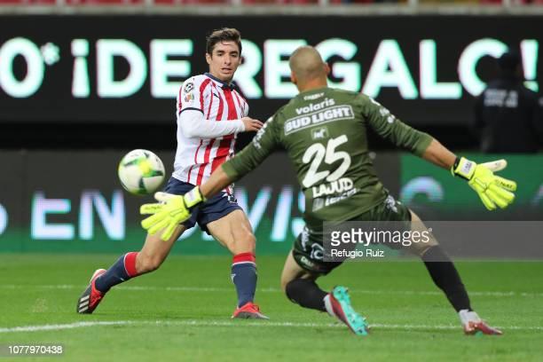 Isaac Brizuela of Chivas kicks the ball against Manuel Lajud goalkeeper of Tijuana during the first round match between Chivas and Tijuana as part of...