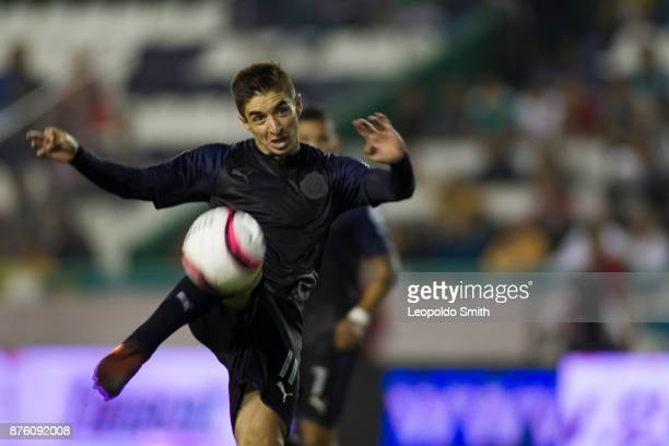 Isaac Brizuela of Chivas kicks the ball during the 17th round match between Leon and Chivas as part of the Torneo Apertura 2017 Liga MX at Leon...