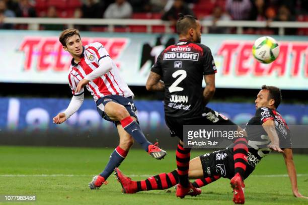 Isaac Brizuela of Chivas scores the second goal of his team during the first round match between Chivas and Tijuana as part of the Torneo Clausura...