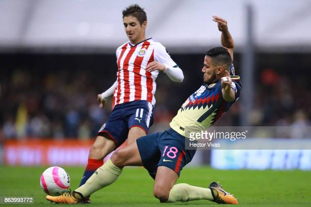 Isaac Brizuela of Chivas struggles for the ball with Bruno Valdez of America during the 10th round match between America and Chivas as part of the...