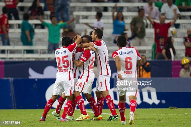 Isaac Brizuela of Toluca and his teammates celebrate the second goal against Atlas during a match between Atlas and Toluca as part of 13th round...