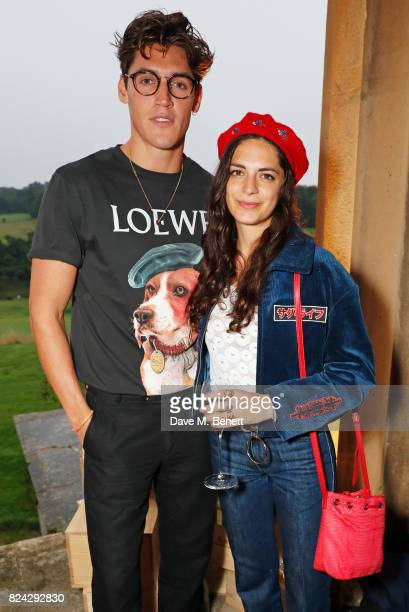 Isaac Carew and Caroline Sharp attend Krug Festival 'Into The Wild' at The Grange Hampshire on July 29 2017 in Northington United Kingdom