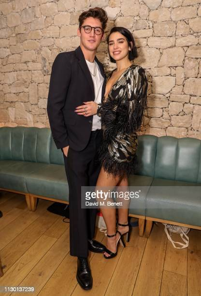 Isaac Carew and Dua Lipa attend the launch of new cookbook The Dirty Dishes by Isaac Carew at Fiume Battersea Power Station on March 12 2019 in...