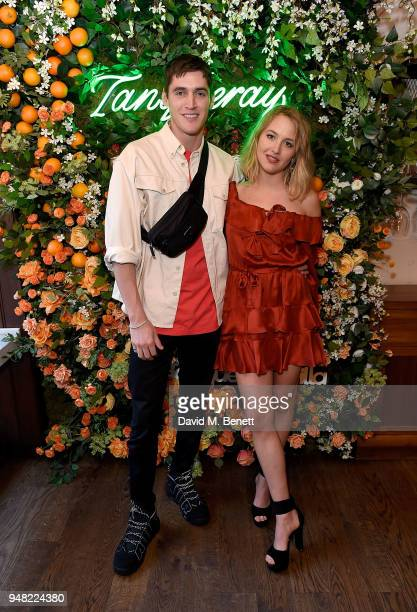 Isaac Carew and Tess Ward attend the launch of new gin Tanqueray Flor de Sevilla in partnership with Jose Pizarro at Pizarro Restaurant on April 18...