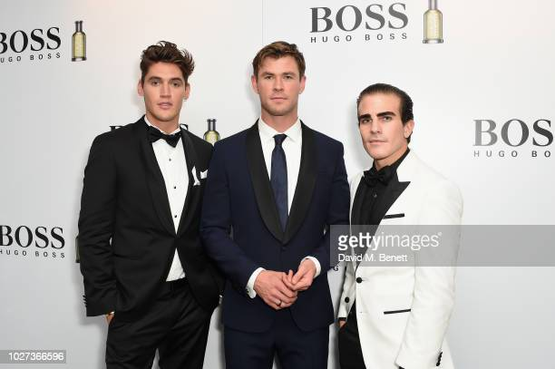 Isaac Carew Chris Hemsworth and Carlo Sestini attend the GQ Men of the Year Awards 2018 in association with HUGO BOSS at Tate Modern on September 5...