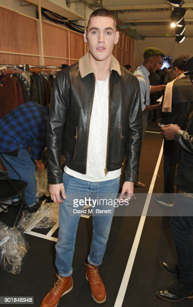 Isaac Carew poses backstage at the Oliver Spencer LFWM AW18 Catwalk Show at the BFC Show Space on January 6 2018 in London England