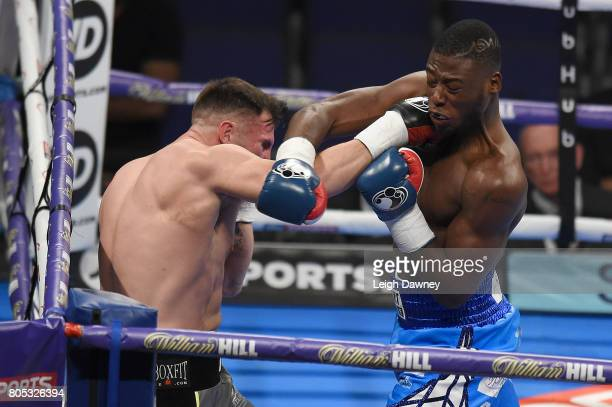 Isaac Chamberlain in boxing action with Ryan Crawford during a Cruiserweight contest at The O2 Arena on July 1 2017 in London England