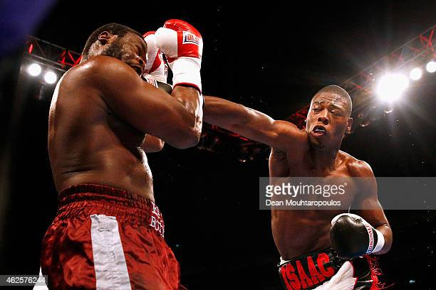 Isaac Chamberlain of England lands a hit on Moses Matovu of Tanzania prior to the WBC Silver Lightweight Title fight between Kevin Mitchell of...