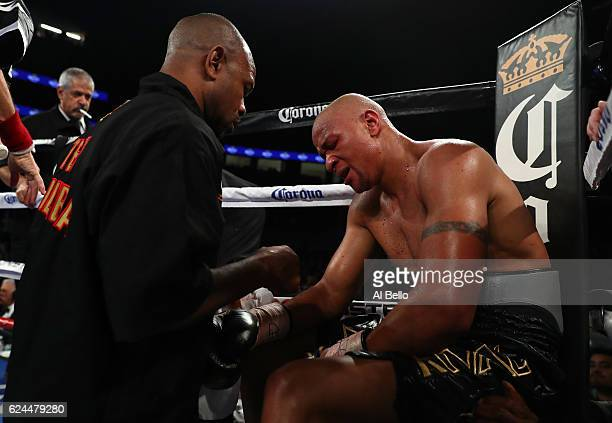 Isaac Chilemba of Malawi grimaces in pain from an injury in his corner after the seventh round of his light heavyweight bout against Oleksandr...