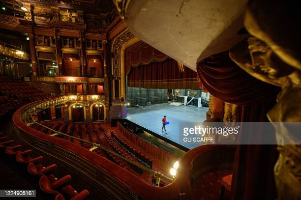 Isaac Clarkson a theatre assistant performs maintenance tasks at the Palace Theatre whilst it remains closed due to Government restrictions in place...