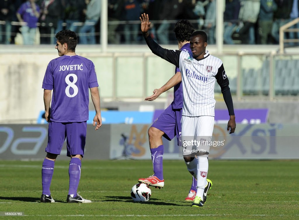 Isaac Cofie of AC Chievo Verona (R) celebrates after scoring the opening goal during the Serie A match between ACF Fiorentina and AC Chievo Verona at Stadio Artemio Franchi on March 3, 2013 in Florence, Italy.