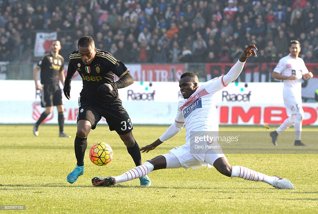Isaac Cofie (R) of Carpi FC competes with Patrice Evra of Juventus FC during the Serie A match between Carpi FC and Juventus FC at Alberto Braglia Stadium on December 20, 2015 in Modena, Italy.