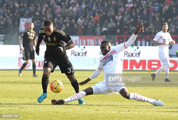 Isaac Cofie of Carpi FC competes with Patrice Evra of Juventus FC during the Serie A match between Carpi FC and Juventus FC at Alberto Braglia...