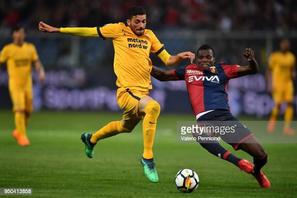 Isaac Cofie of Genoa CFC tackles Mattia Valoti of Hellas Verona FC during the Serie A match between Genoa CFC and Hellas Verona FC at Stadio Luigi...