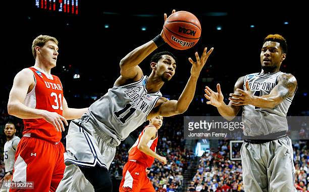 Isaac Copeland of the Georgetown Hoyas controls the ball against Dallin Bachynski of the Utah Utes in the first half during the third round of the...