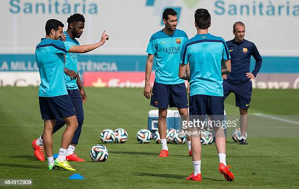Isaac Cuenca Sergio Busquets Alex Song and Pedro Rodriguez of FC Barcelona play with the ball during the trainig session at Ciutat Esportiva on April...