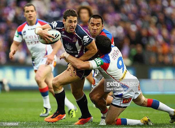 Isaac De Gois of the Knights tackles Billy Slater of the Storm during the NRL 4th Qualifying Final match between the Melbourne Storm and the...
