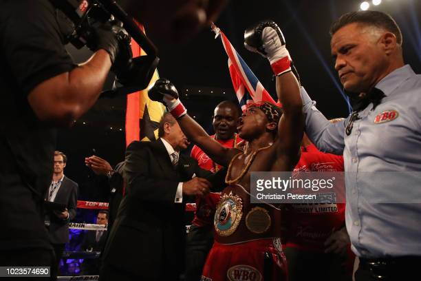Isaac Dogboe of Ghana celebrates his win by knock out over Hidenori Otake during the WBO junior featherweight championship bout at Gila River Arena...