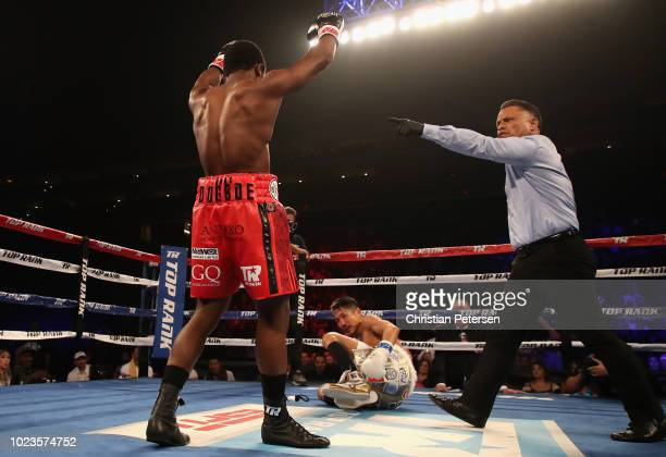 Isaac Dogboe of Ghana reacts to a knock down punch against Hidenori Otake of Japan during the WBO junior featherweight championship bout at Gila...
