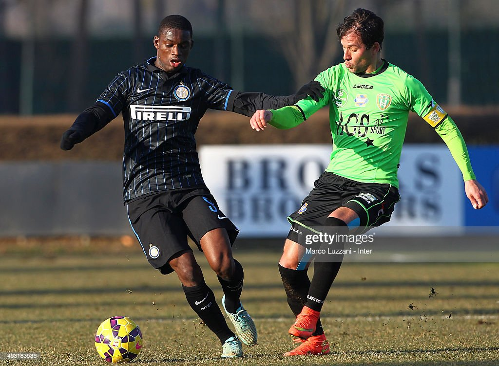 Isaac Donkor (L) of FC Internazionale Milano competes for the ball during FC Internazionale training session at the club's training ground on February 11, 2015 in Como, Italy.