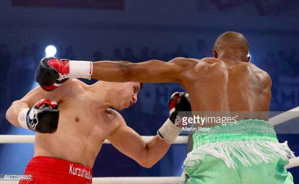 Isaac Ekpo of Nigeria and Tyron Zeuge of Germany exchange punches during their WBA super middleweight championship title fight at MBS Arena on March...