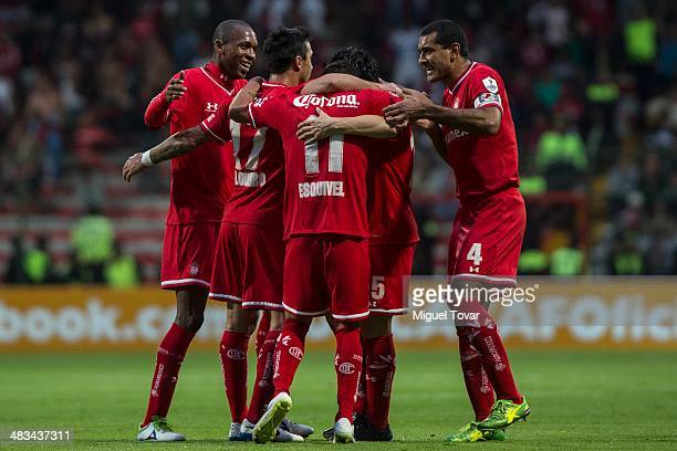 Isaac Esquivel celebrates with teammates after scoring during a semifinal match between Toluca and Alajuelense as part of the CONCACAF Liga de...
