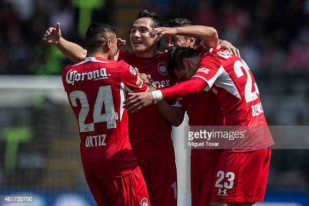 Isaac Esquivel of Toluca celebrates with teammates after scoring during a match between Toluca and Chiapas as part of 2nd round Clausura 2015 Liga MX...