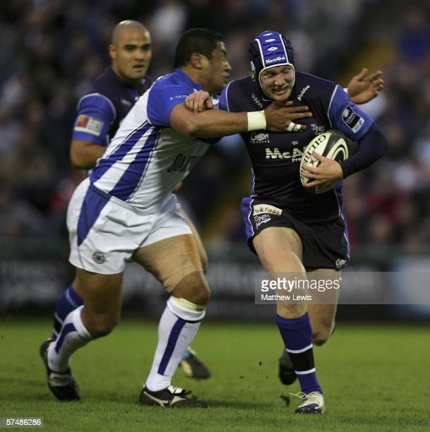 Isaac Feaunati of Bath tackles Magnus Lund of Sale during the Guinness Premiership match between Sale Sharks and Bath at Edgeley Park on April 28,...