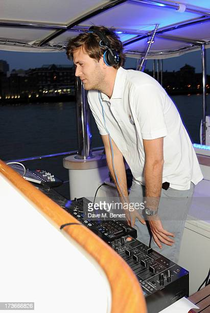 Isaac Ferry DJ's at the Johnnie Walker Blue Label drinks reception aboard the John Walker & Sons Voyager on July 16, 2013 in London, England.