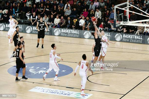 Isaac Fotu of New Zealand competes for a rebound against Abudushalamu Abudurexiti of China during the FIBA World Cup Qualifying match between the New...