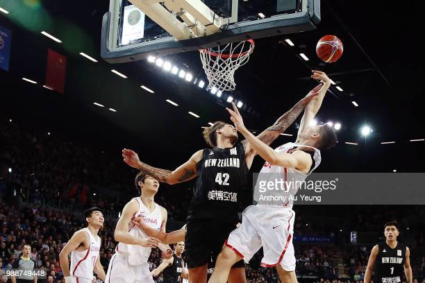 Isaac Fotu of New Zealand contests the shot from Abudushalamu Abudurexiti of China during the FIBA World Cup Qualifying match between the New Zealand...