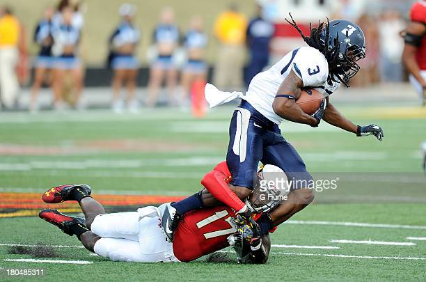 Isaac Goins of the Maryland Terrapins tackles Marquel Thomas of the Old Dominion Monarchs at Byrd Stadium on September 7 2013 in College Park Maryland