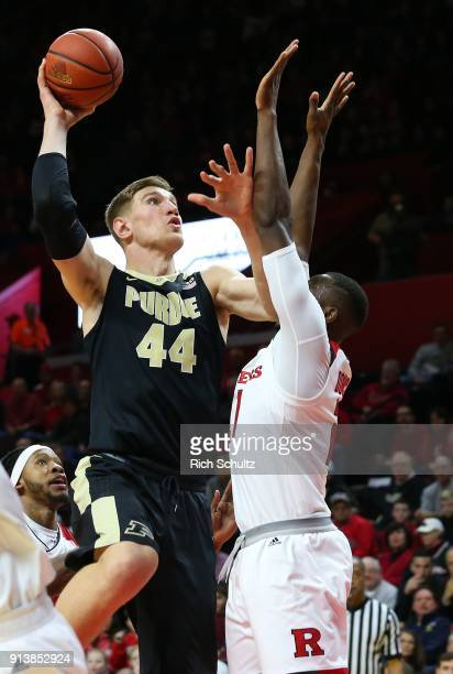 Isaac Haas of the Purdue Boilermakers attempts a shot as Mamadou Doucoure of the Rutgers Scarlet Knights defends during the first half of a game at...