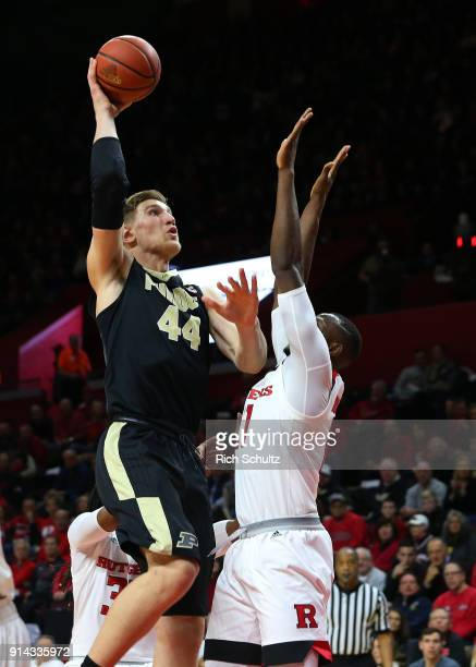 Isaac Haas of the Purdue Boilermakers attempts a shot as Mamadou Doucoure of the Rutgers Scarlet Knights defends during the second half of a game at...