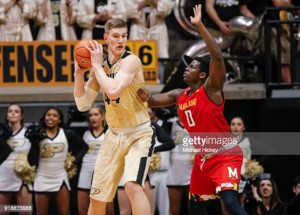Isaac Haas of the Purdue Boilermakers backs into Sean Obi of the Maryland Terrapins at Mackey Arena on January 31 2018 in West Lafayette Indiana