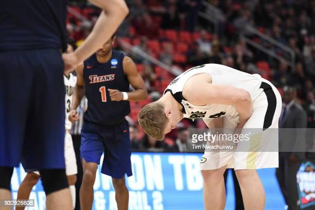 Isaac Haas of the Purdue Boilermakers bends over after sustaining an injury in the first round of the 2018 NCAA Men's Basketball Tournament held at...