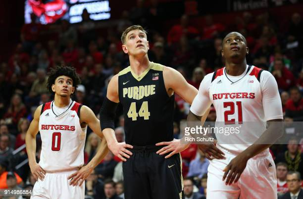 Isaac Haas of the Purdue Boilermakers between Geo Baker and Mamadou Doucoure of the Rutgers Scarlet Knights during a game at Rutgers Athletic Center...