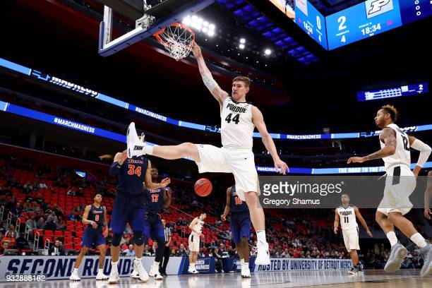 Isaac Haas of the Purdue Boilermakers dunks the ball against the Cal State Fullerton Titans during the first half of the game in the first round of...