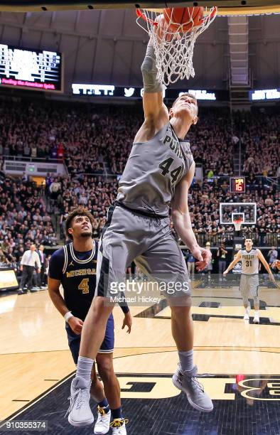Isaac Haas of the Purdue Boilermakers dunks the ball during the game against the Michigan Wolverines at Mackey Arena on January 25 2018 in West...