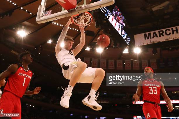 Isaac Haas of the Purdue Boilermakers dunks the ball in the first half against the Rutgers Scarlet Knights during quarterfinals of the Big Ten...