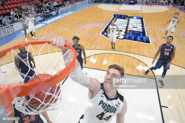 Isaac Haas of the Purdue Boilermakers goes up for a dunk over the Cal State Fullerton Titans in the first round of the 2018 NCAA Men's Basketball...