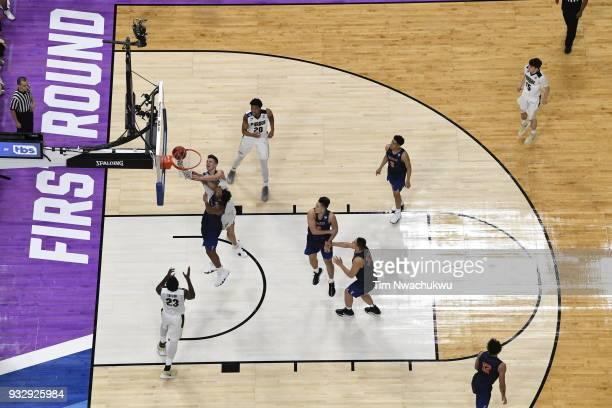 Isaac Haas of the Purdue Boilermakers goes up for a layup in the first round of the 2018 NCAA Men's Basketball Tournament held at Little Caesars...