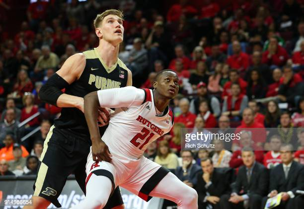 Isaac Haas of the Purdue Boilermakers in action against Mamadou Doucoure of the Rutgers Scarlet Knights during a game at Rutgers Athletic Center on...