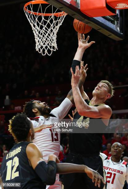 Isaac Haas of the Purdue Boilermakers in action against Matt Bullock of the Rutgers Scarlet Knights during a game at Rutgers Athletic Center on...