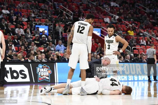 Isaac Haas of the Purdue Boilermakers lays on the ground after sustaining an injury in the first round of the 2018 NCAA Men's Basketball Tournament...