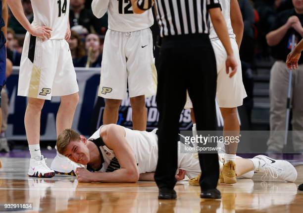 Isaac Haas of the Purdue Boilermakers lies on the court with an injury during the NCAA Division I Men's Basketball First Round game between the...